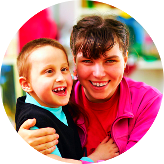 disabled woman and a kid smiling
